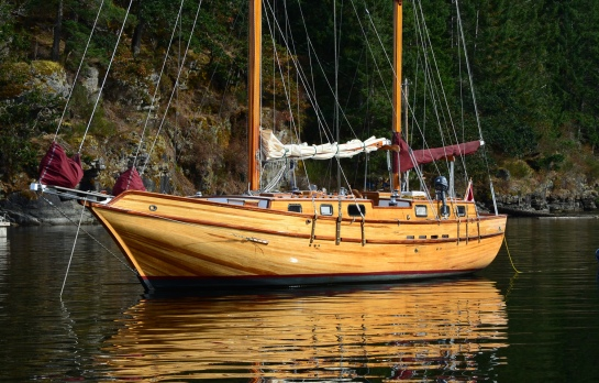 Beautiful strip-planked Wildwood, built on Vancouver Island, seen here in Maple Bay, on her way to the Victoria Classic Boat Festival.