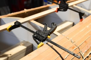 Here the clamps are reversed to push against the maple keel.